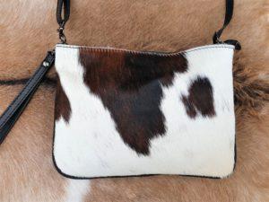 Koe gevlekt middelmaat koeienhuid tasje afgewerkt met leer