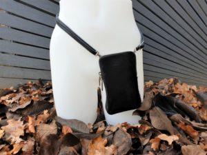 Zwart koeienhuid telefoontasje, heuptasje, schoudertasje